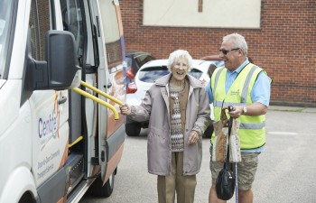 Community Transport driver is assisting a Centre 81 door to door member onto one of our fully accessible buses.